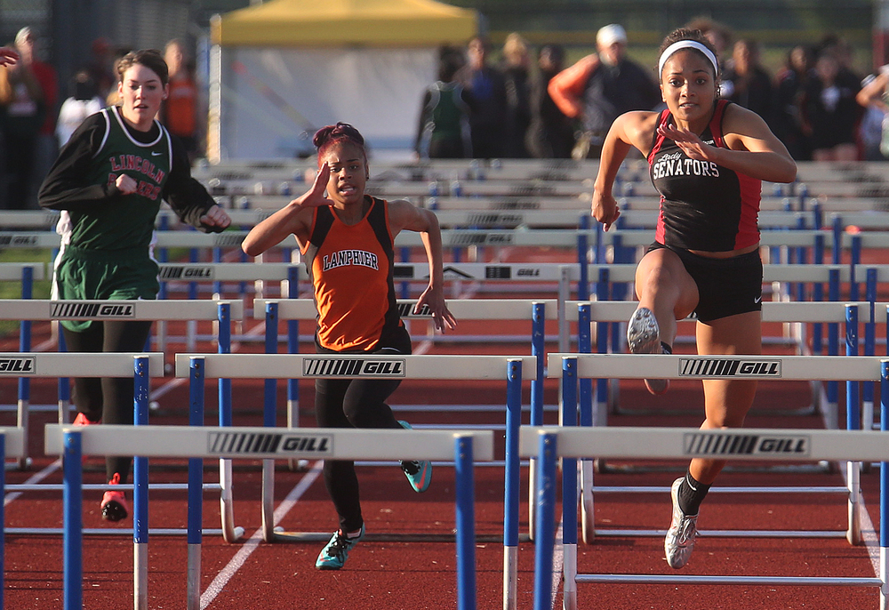 In the 100 meter hurdles, Springfield High School's Kyra Webster at right crossed the finish line in first place in 15.84 seconds. David Spencer/The State Journal-Register