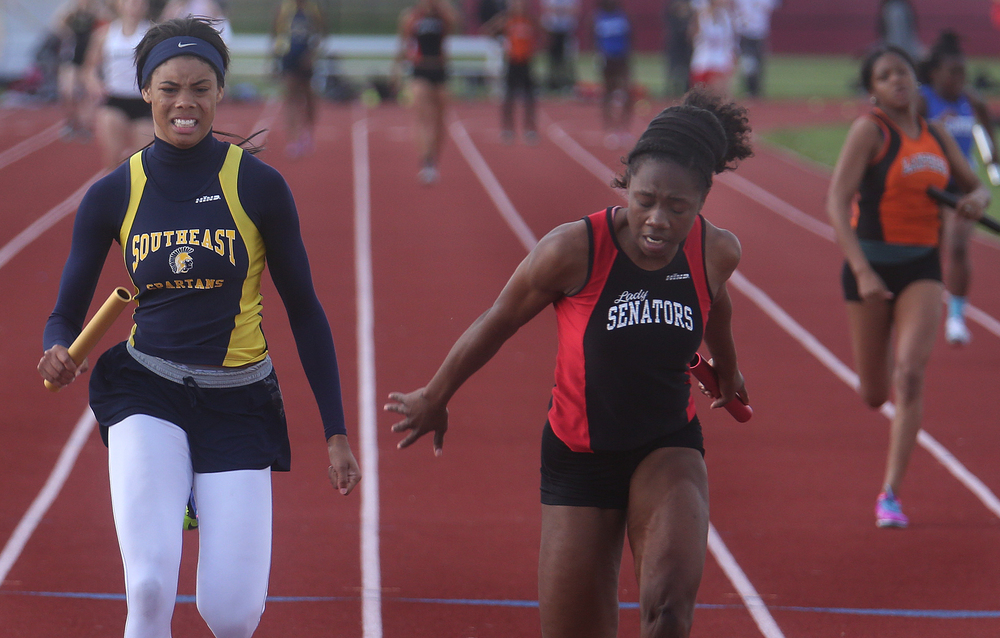 In the 4 x 100 meter relay, Springfield anchor leg Ozzy Erewele at right broke the tape in first place in 48.90 seconds just in front of second place finisher Southeast, with Jamari Drake running the anchor at left. David Spencer/The State Journal-Register