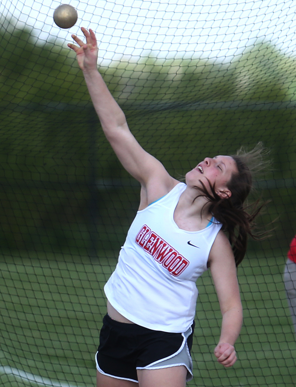 Glenwood's Mackenzie Bray shows her form en route to placing first in the shot put with a heave of 37-07.50 feet. Bray also won the discus event. David Spencer/The State Journal-Register