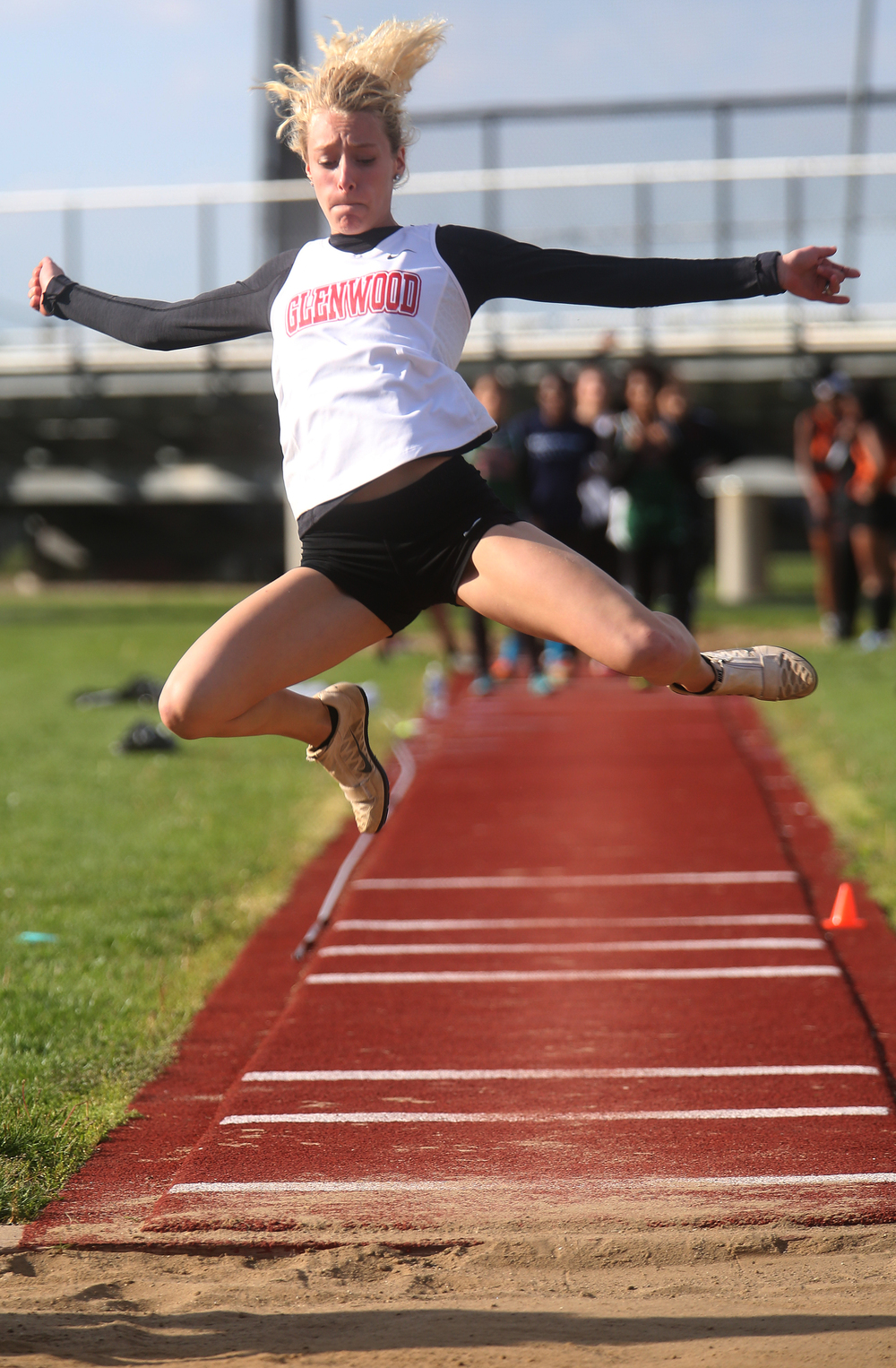 Glenwood High School's Alison Woerner goes airborne in capturing first place overall in the triple jump event with a leap of 36-5.25 feet. David Spencer/The State Journal-Register