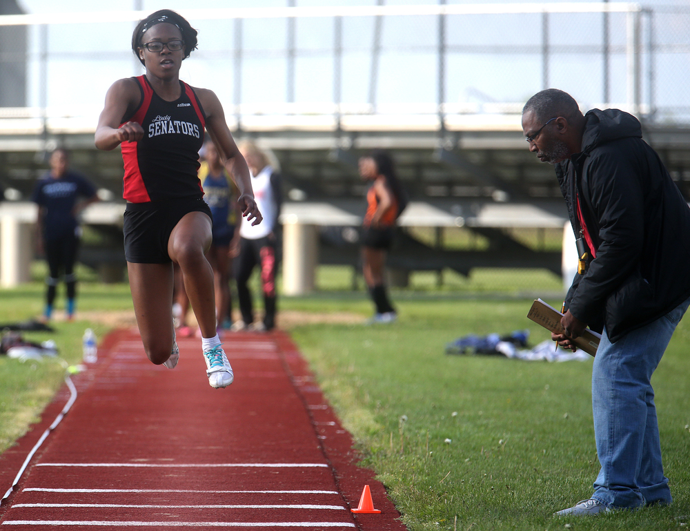 Springfield High School's Chieme Udaku came in third overall in the triple jump event with a leap of 34.00 feet. David Spencer/The State Journal-Register