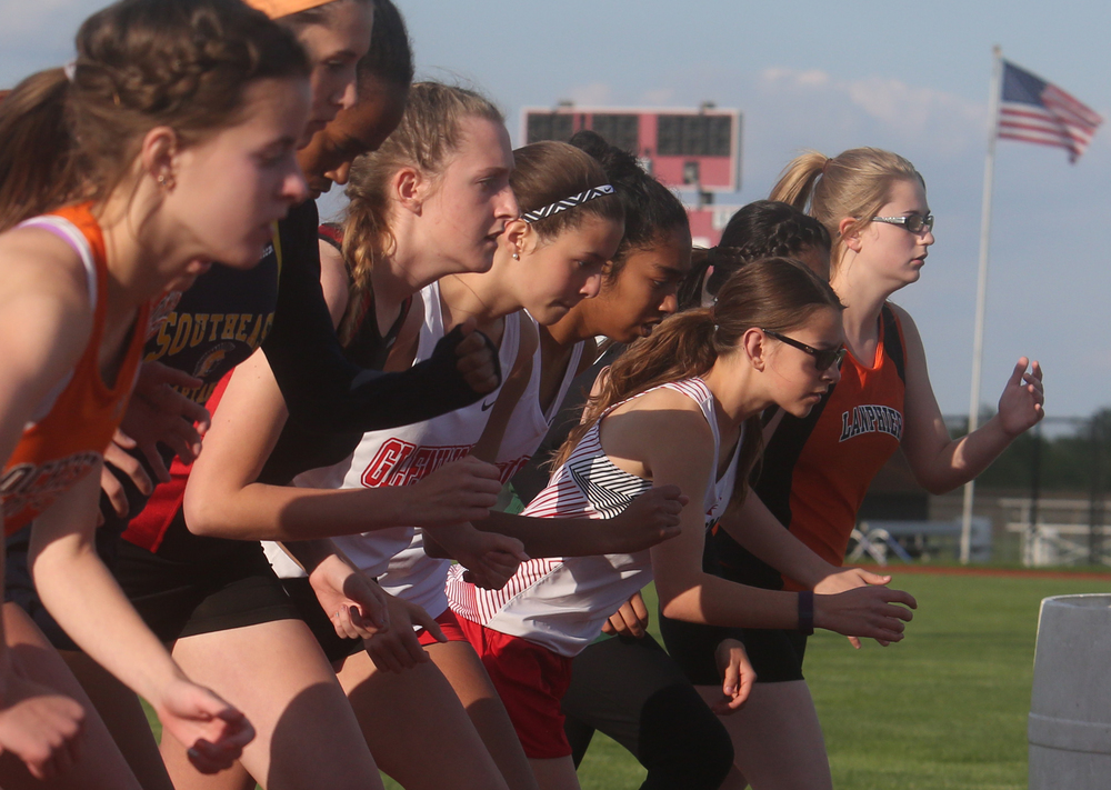 Runners take off at the beginning of the 3200 meter run, which was eventually won by Springfield High School's Natalie Motor. David Spencer/The State Journal-Register