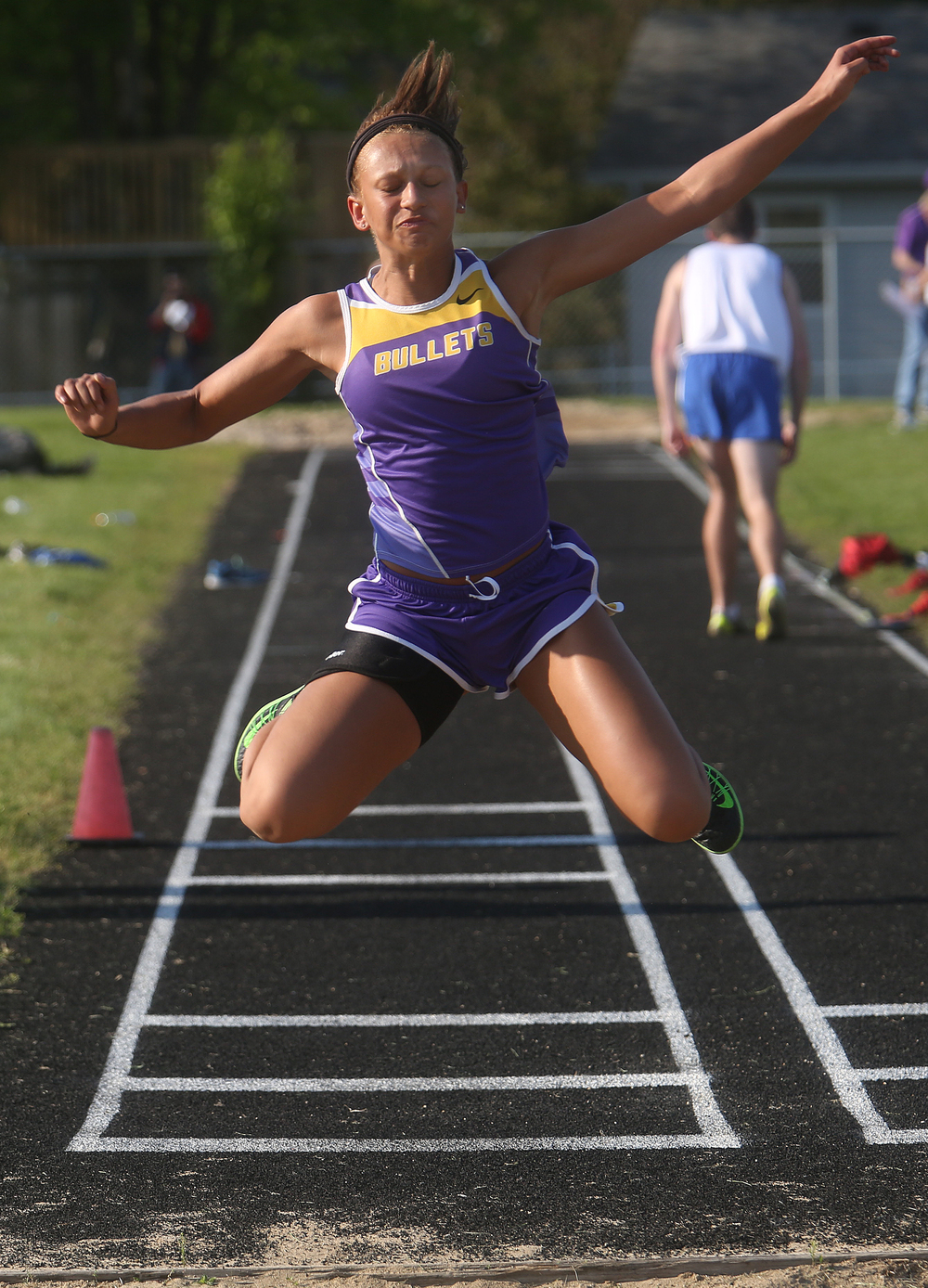 Williamsville's Cheyanna Michael is seen here jumping 34.3.00 feet in the triple jump to win first place in the event. David Spencer/The State Journal-Register