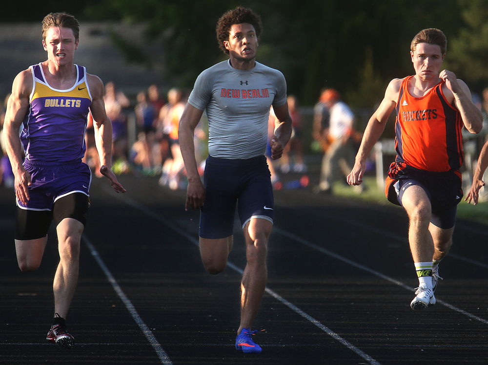 New Berlin's Kahlil Wassell at center ran 10.94 seconds to win the 100 meter dash on Friday. David Spencer/The State Journal-Register