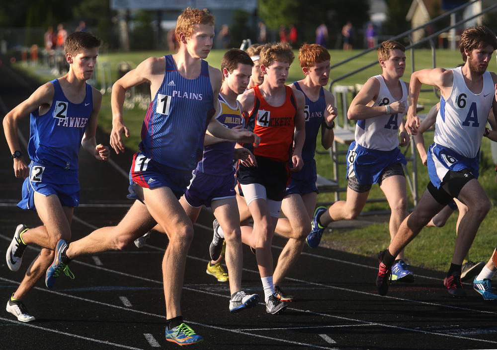 The longest held record of the county meet dating back to 1977 was broken when Pleasant Plains runner Tyler Johnson at left (seen here starting the race) beat Dave James record with a time of 9:40.84 minutes. James also attended Pleasant Plains. David Spencer/The State Journal-Register