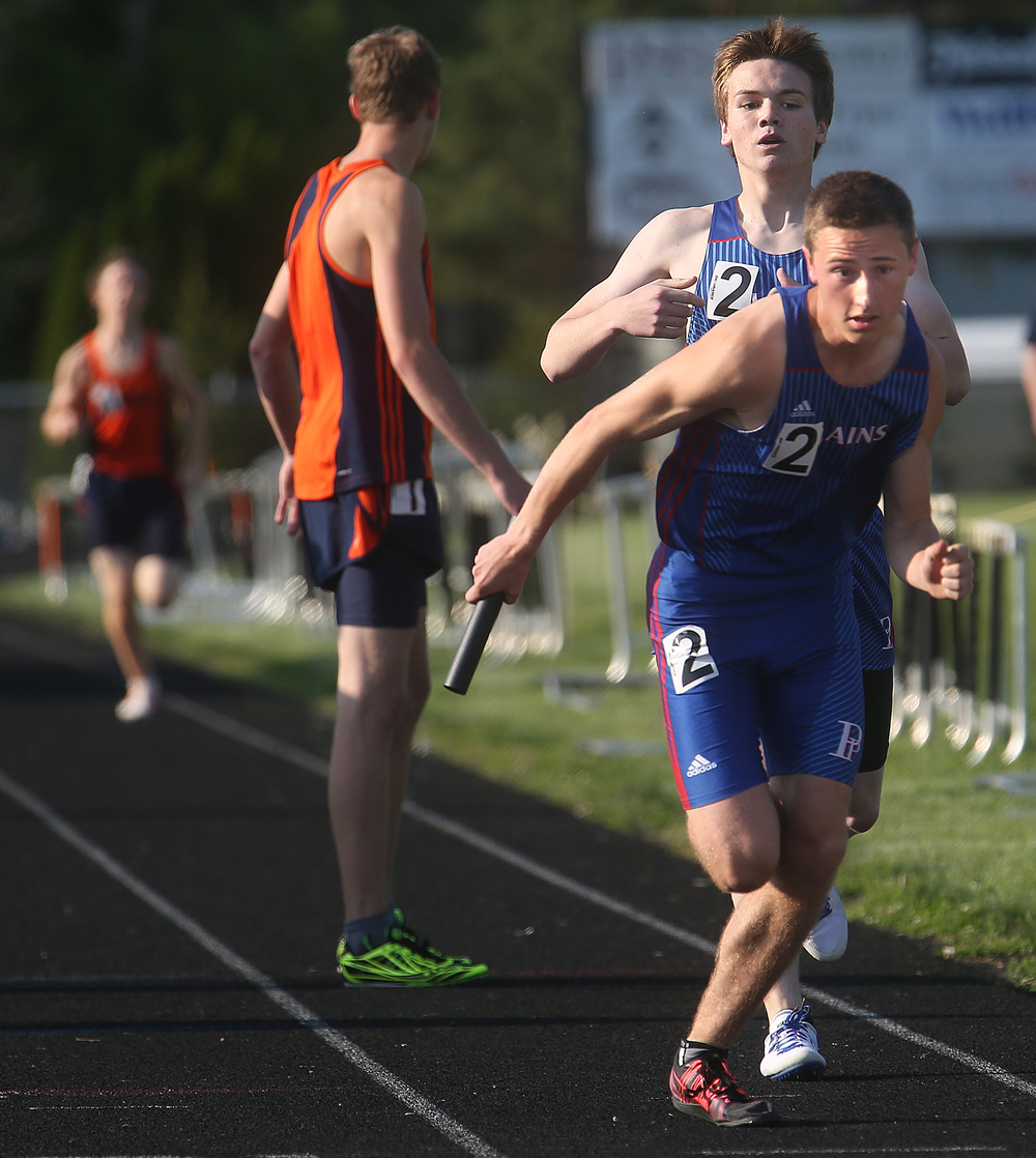 Pleasant Plains won the boys 4 x 800 meter relay event friday. Anchor Luke McGraw at front receives the final handoff from teammate Dave Plunkett. David Spencer/The State Journal-Register