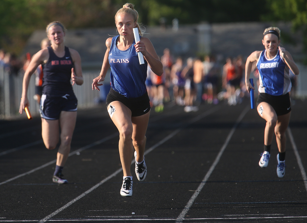 Pleasant Plains won the girls 4 x 100 meter relay event friday. Anchor Hope Tewes at center crosses the finish line ahead of New Berlin and Auburn. David Spencer/The State Journal-Register