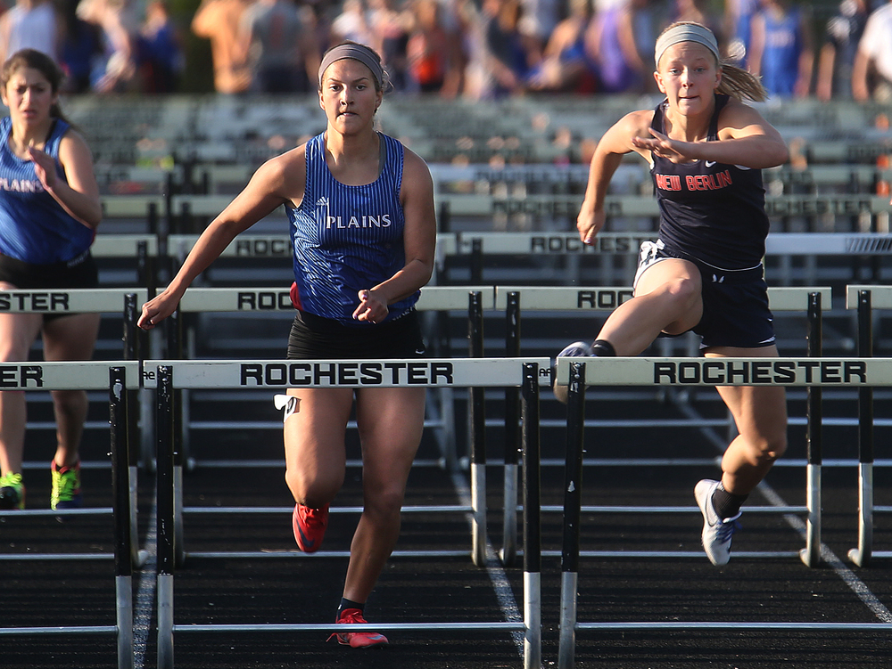New Berlin's Alyssa Vignos at right edged out Pleasant Plains hurdler Amber Clouser at left to win the girls 100 meter hurdle event Friday. Clouser earlier won the long jump event. David Spencer/The State Journal-Register