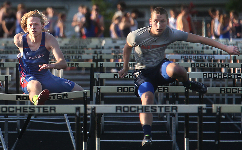 New Berlin's Evan Gustafson at right edged out Pleasant Plains hurdler Jakob Verhulst at left to win the boys 110 meter hurdles event with a time of 16.12 seconds. David Spencer/The State Journal-Register