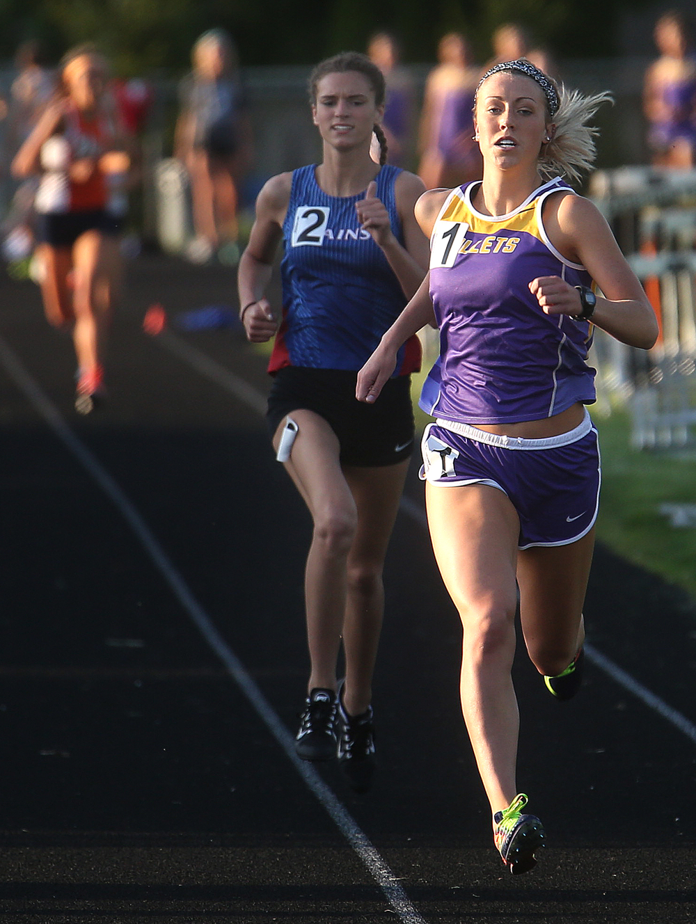 Williamsville's Abbey Galusha at front beat Pleasant Plains runner Ali Pankey behind her to win the girls 800 meter run on Friday. David Spencer/The State Journal-Register
