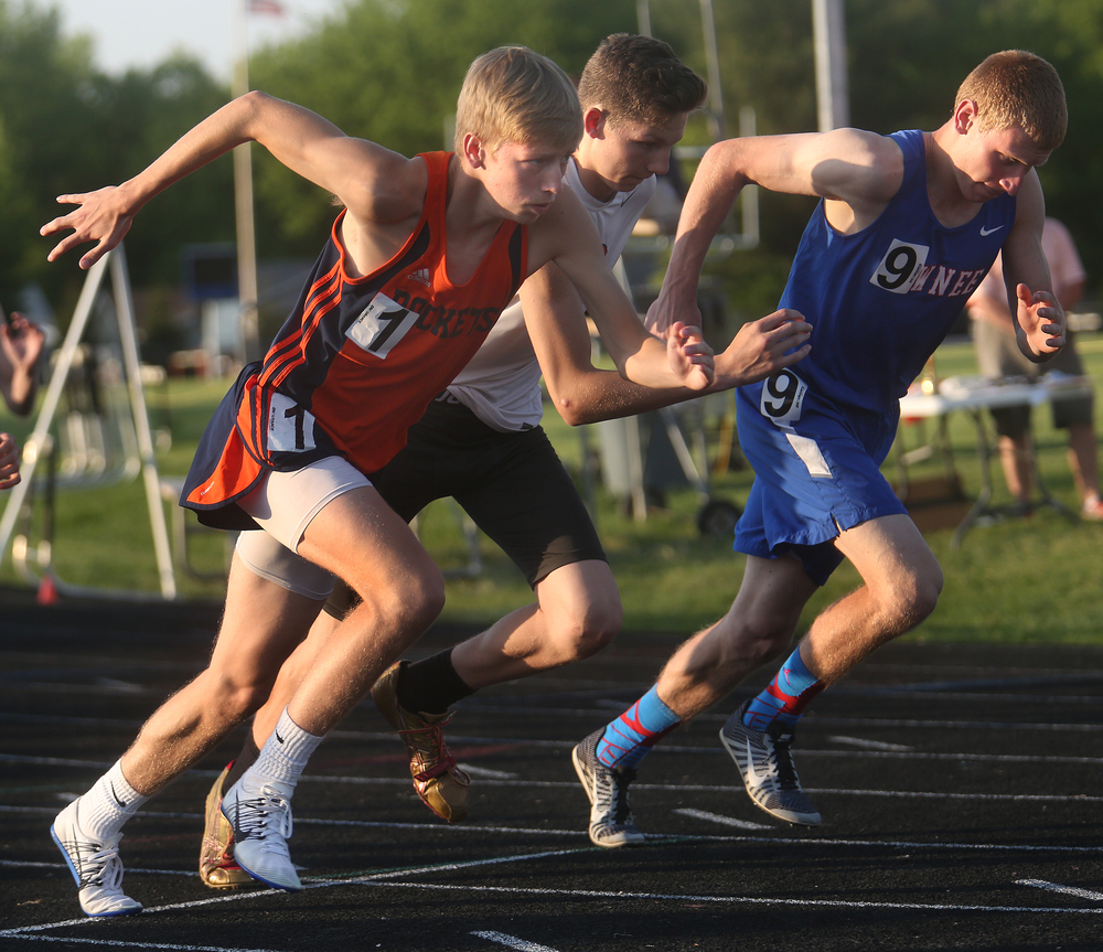 Rochester's Josh Cable starts out at left to win the boys 800 meter run on Friday. David Spencer/The State Journal-Register