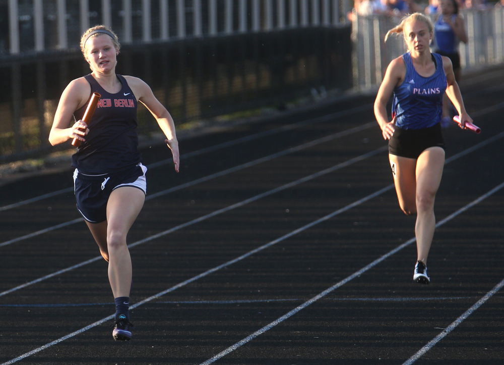 New Berlin wins the girls 4 x 200 meter race ahead of Pleasant Plains on Friday. David Spencer/The State Journal-Register