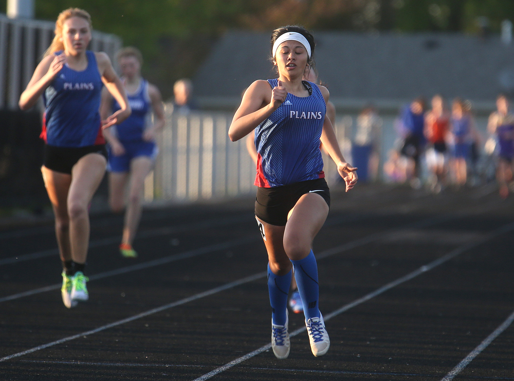 Pleasant Plains runner Kortney Klockenga crosses the finish line first to win the girls 400 meter race on Friday. David Spencer/The State Journal-Register
