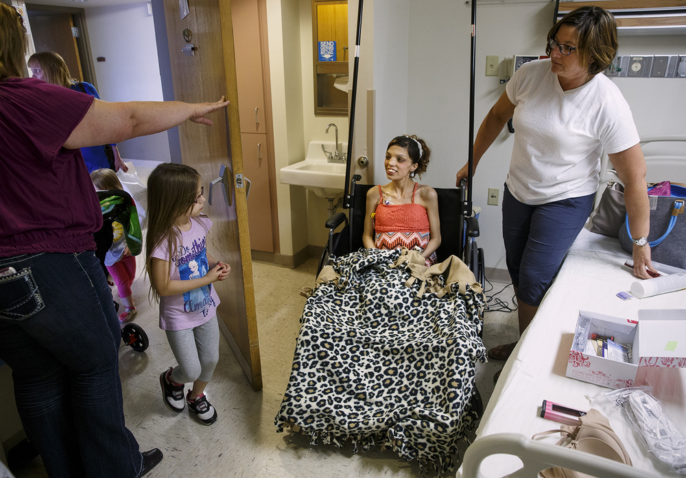 Nyna Merit stops in to say hello to her future step-mother Destini Schafer before her wedding ceremony at Memorial Medical Center Friday, May 6, 2016. Ted Schurter/The State Journal-Register