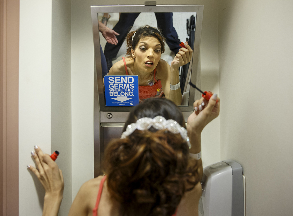 Destini Schafer applies makeup using the small mirror in her hospital room before her wedding ceremony at Memorial Medical Center Friday, May 6, 2016.  Ted Schurter/The State Journal-Register