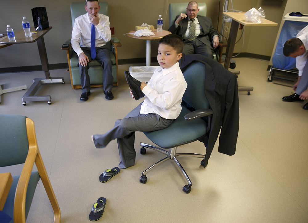 Jacob Coffey trades flip flops for dress shoes as he prepares for his role of ring bearer at Destini Schafer and Brandon Thomas' wedding at Memorial Medical Center Friday, May 6, 2016.  Ted Schurter/The State Journal-Register
