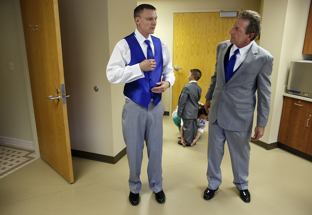 Mike Thomas, right, checks his son Brandon's outfit as they prepare for a wedding ceremony at Memorial Medical Center Friday, May 6, 2016. Ted Schurter/The State Journal-Register