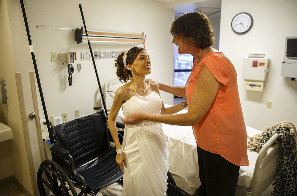 Destini Schafer hugs her Lisa Ishmael who stopped in to check on her before her wedding ceremony at Memorial Medical Center Friday, May 6, 2016. Ted Schurter/The State Journal-Register