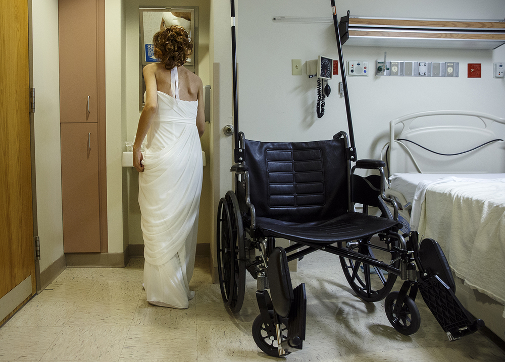 Destini Schafer stands to check her hair and makeup one last time before her wedding ceremony at Memorial Medical Center Friday, May 6, 2016. Ted Schurter/The State Journal-Register