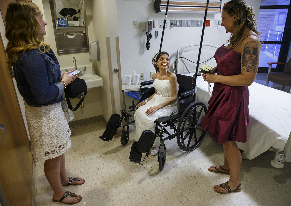 Destini Schafer smiles at her maid of honor Tiffany Gribbins as she prepares to go down to her wedding ceremony with Kloee Schmulbach, left, at Memorial Medical Center Friday, May 6, 2016. Ted Schurter/The State Journal-Register