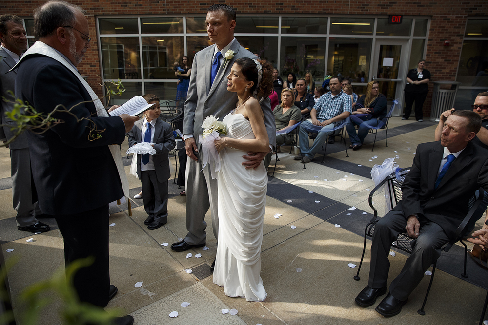 Reverend Greg Stafford officiates the wedding of Brandon Thomas and Destini Schafer in a courtyard at Memorial Medical Center Friday, May 6, 2016. Ted Schurter/The State Journal-Register