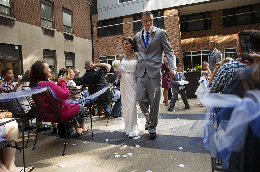 Brandon Thomas and Destini Schafer walk down the aisle after their wedding ceremony in a courtyard at Memorial Medical Center Friday, May 6, 2016.  Ted Schurter/The State Journal-Register
