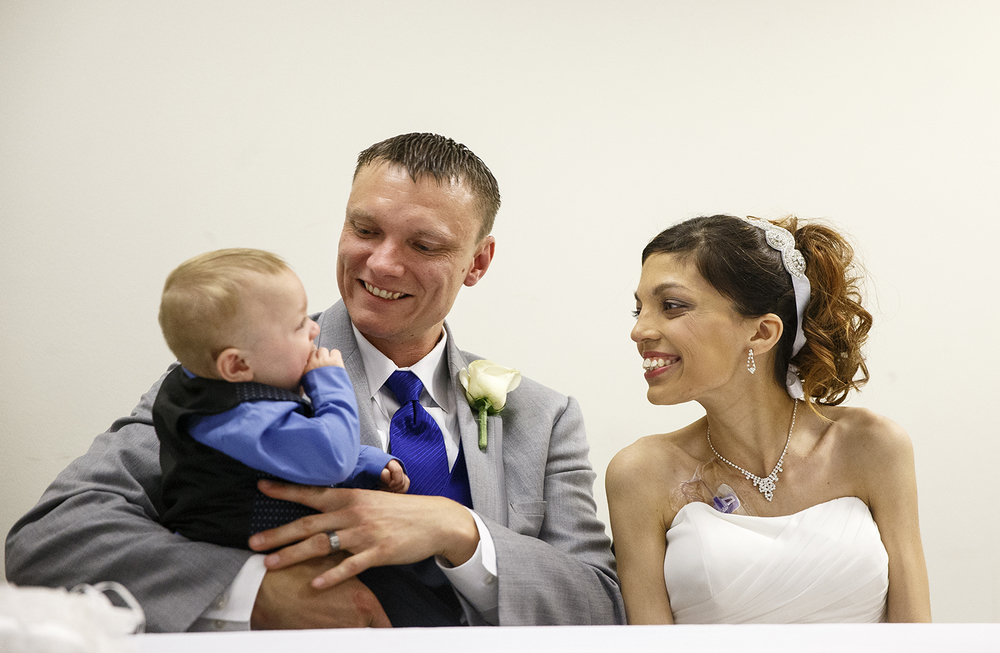 Brandon Thomas and Destini Schafer smile at their son Noah during their wedding reception at Memorial Medical Center Friday, May 6, 2016. Ted Schurter/The State Journal-Register