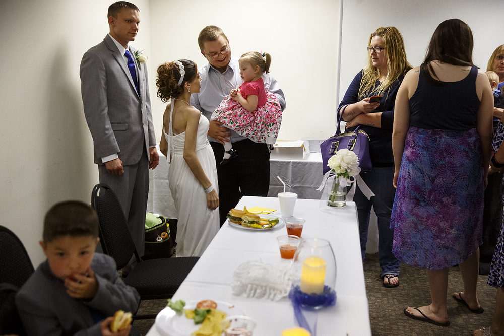 Brandon Thomas and Destini Schafer greet guests during their wedding reception at Memorial Medical Center Friday, May 6, 2016. Ted Schurter/The State Journal-Register