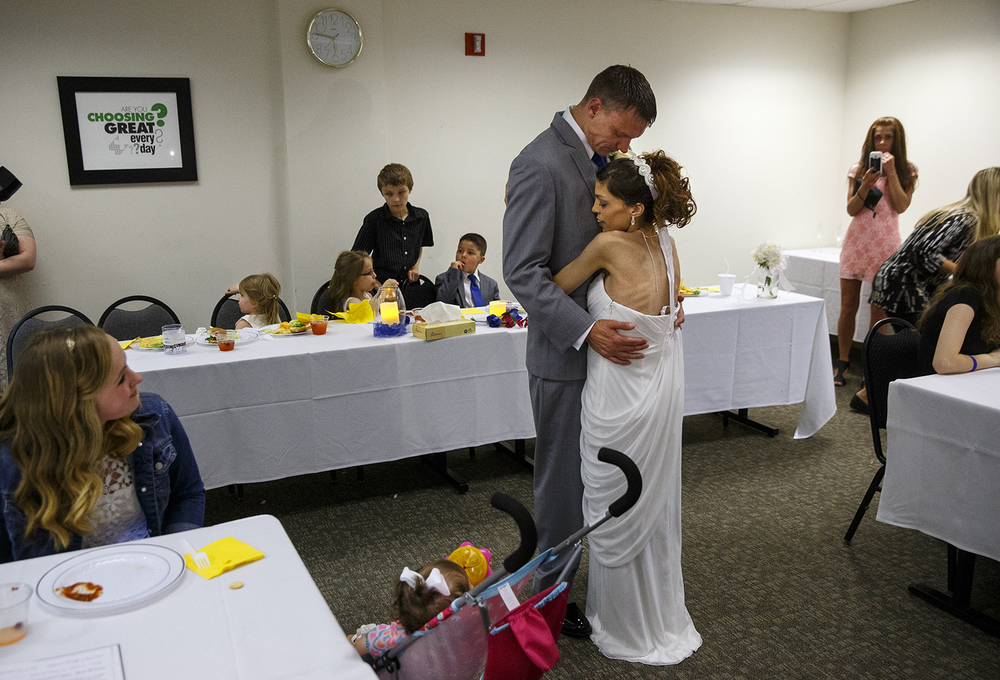 Brandon Thomas and Destini Schafer dance their first dance during their wedding reception at Memorial Medical Center Friday, May 6, 2016. Ted Schurter/The State Journal-Register