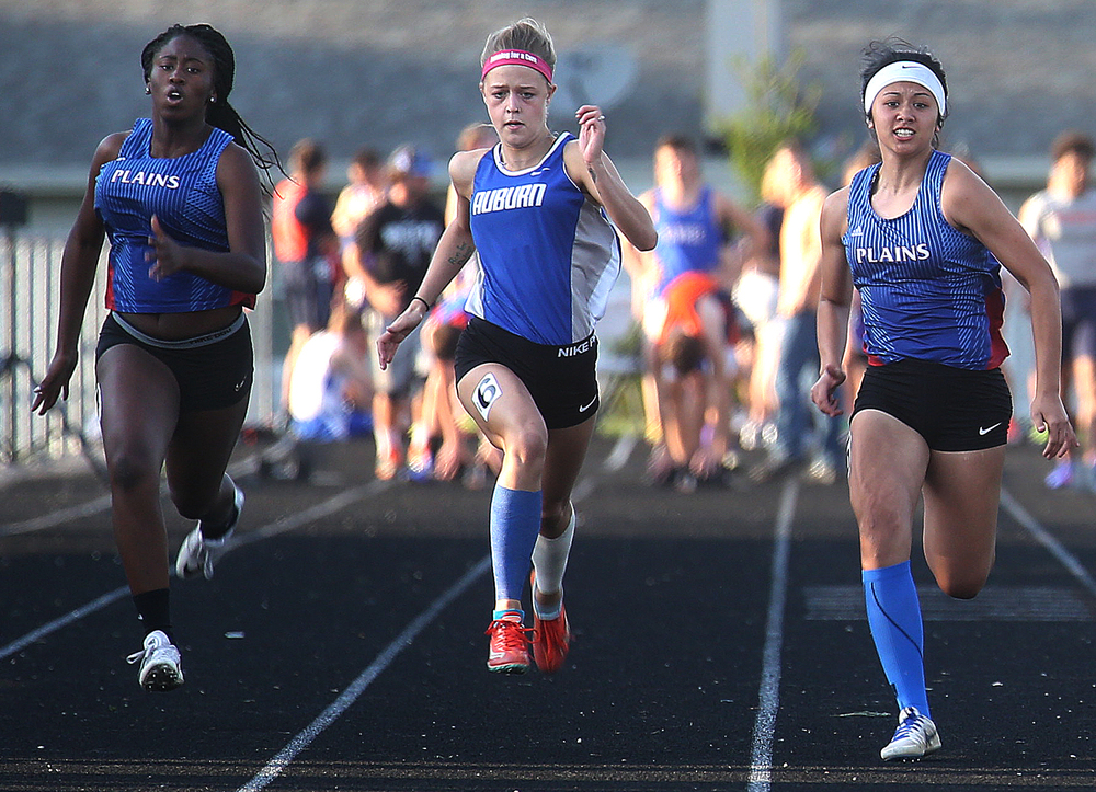 Auburn's Rebecca Downs at center ended up winning the girls 100 meter dash on Friday. David Spencer/The State Journal-Register