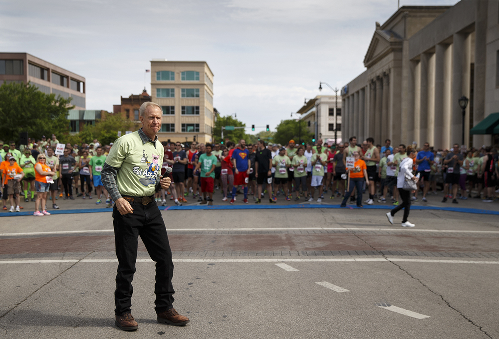 Governor Bruce Rauner greeted the crowd before the start of the Fat Ass 5K in downtown Springfield Saturday, May 7, 2016. Ted Schurter/The State Journal-Register