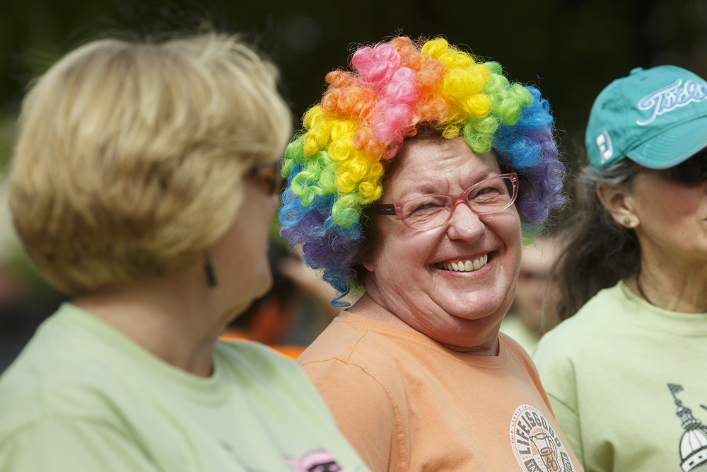 Sheri Pohlman donned the wig her mother wore when she would entertain at nursing homes before participating in the Fat Ass 5K in downtown Springfield Saturday, May 7, 2016. Pohlman said she wore the wig in her mother's honor. Ted Schurter/The State Journal-Register