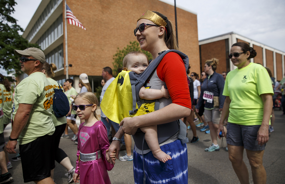 Elizabeth Wright and her children Amelia, left, and Lexi join her for the Fat Ass 5K in downtown Springfield Saturday, May 7, 2016. Ted Schurter/The State Journal-Register