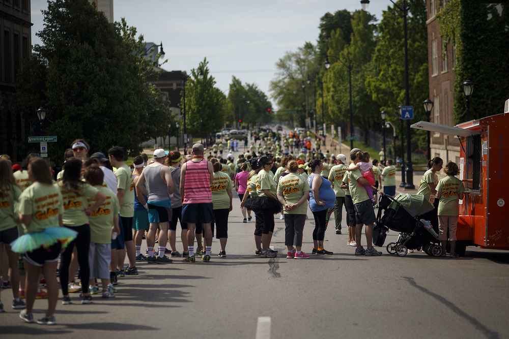 Participants line up for shaved ice, one of many snacks and beverages available on the route of the Fat Ass 5K in downtown Springfield Saturday, May 7, 2016. Ted Schurter/The State Journal-Register