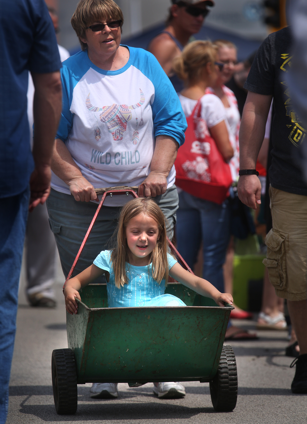 An old garden cart probably dating to the 1960's was purchased by Deb Cox of Hillsboro during the market. She said she planned to convert it to a planter for flowers-after she finished using it for more practical considerations: wheeling granddaughter Hayden Rommerskirchen, 6, around during the market. David Spencer/The State Journal-Register