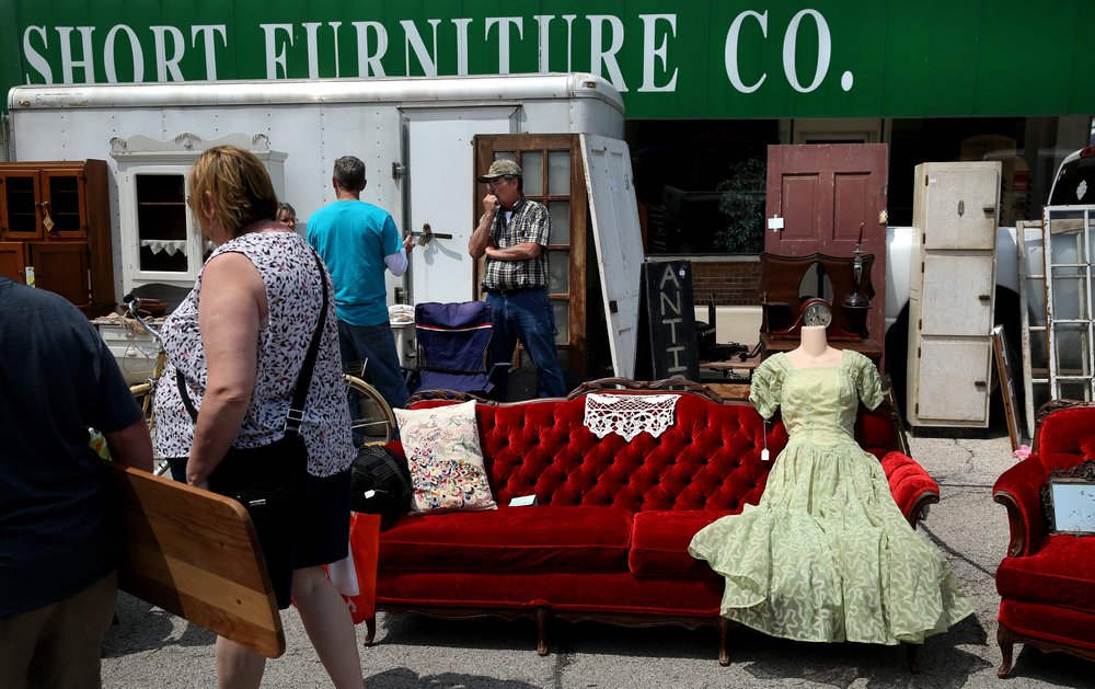 A fancy vintage dress fit on a mannequin form shared space with a deep-red sofa pm State Street Sunday during the market.  David Spencer/The State Journal-Register