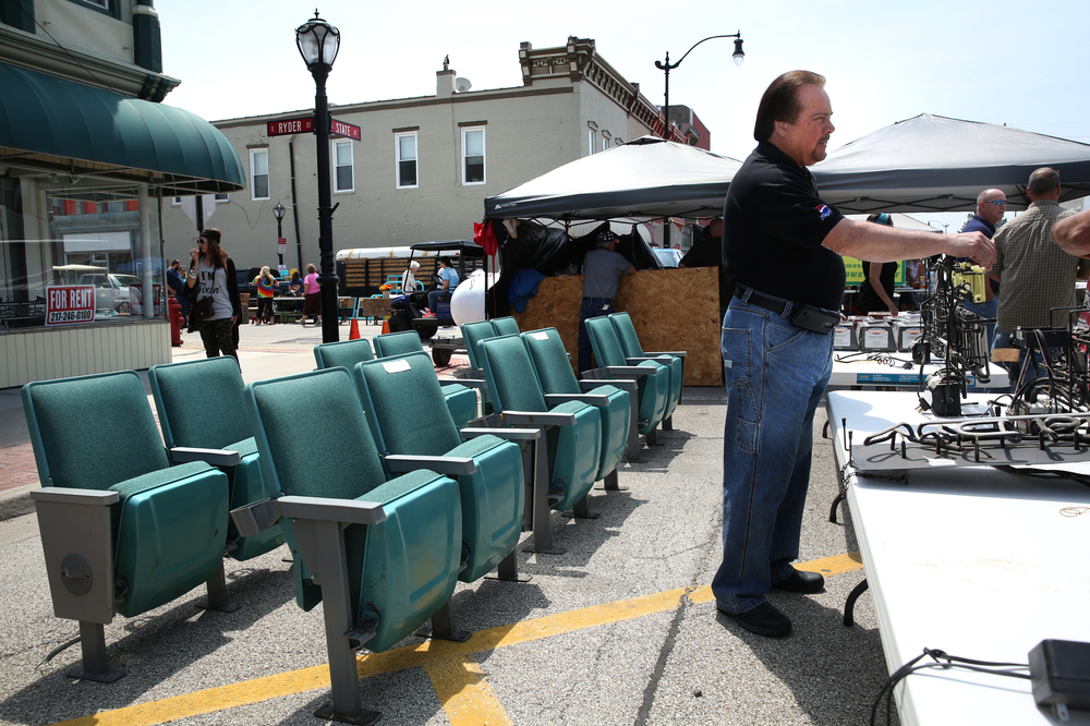 Litchfield mayor Steve Dougherty at right was selling movie seats from the 1970's he had removed from a theatre he owns in Jerseyville that has been refurbished for $25.00 a set. David Spencer/The State Journal-Register