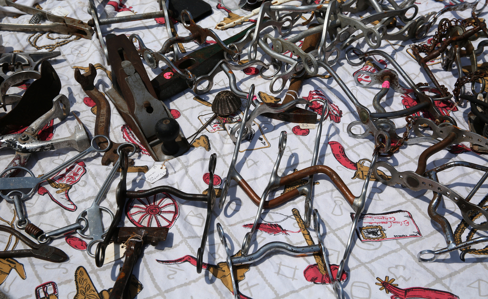 A table of horse tack and antique tools for sale on Sunday. David Spencer/The State Journal-Register