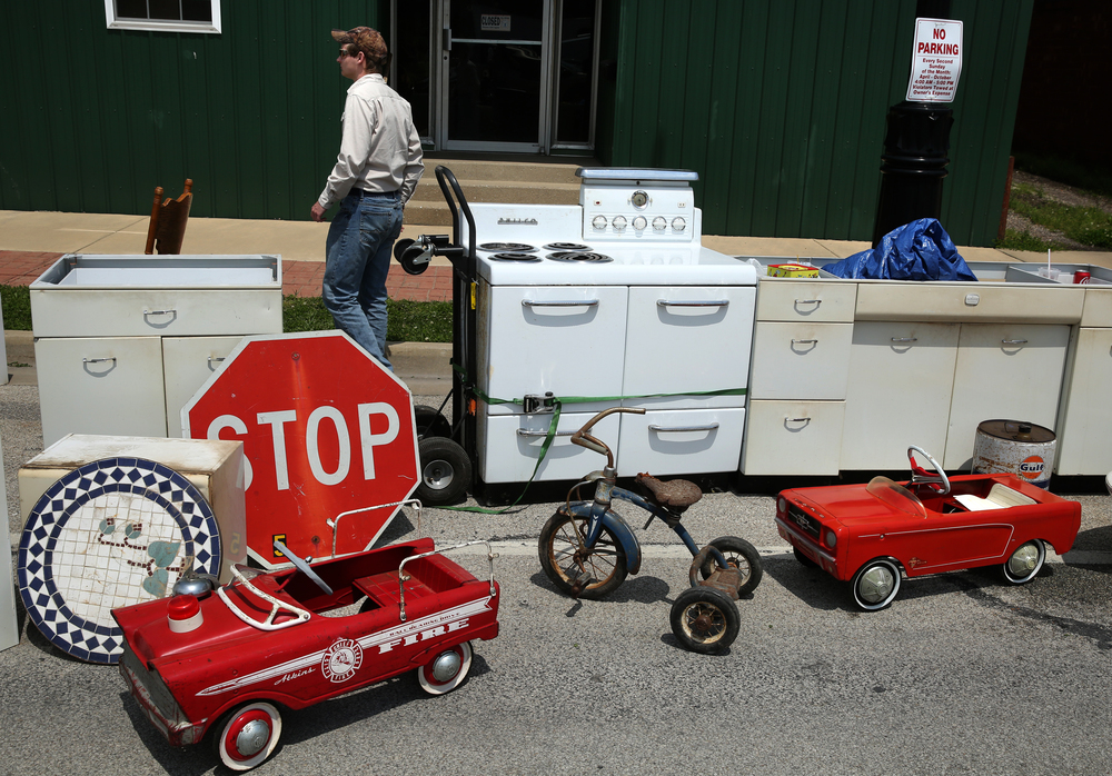 A little bit of this and a little bit of that: an electric Philco brand stove takes up space with some antique peddle toys off of State St. David Spencer/The State Journal-Register