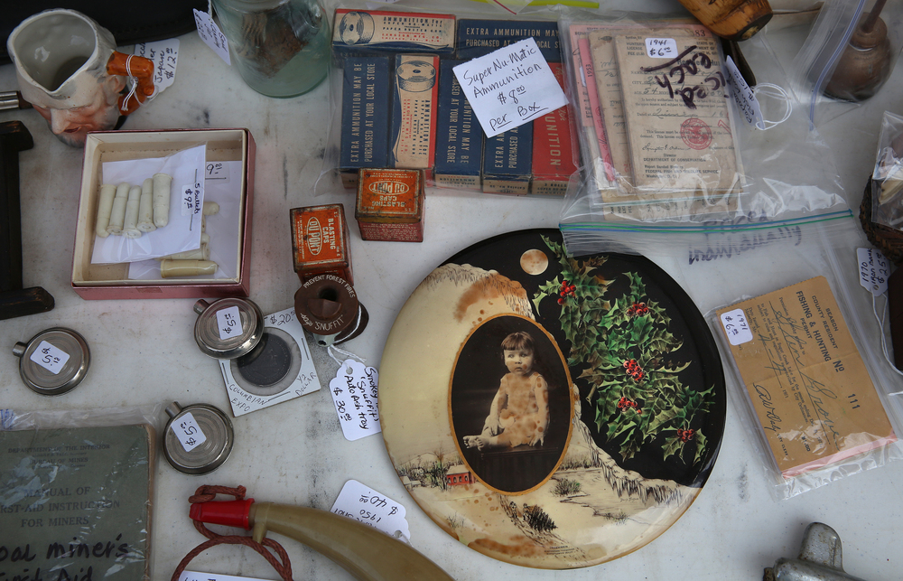 "A details from an ecletic table of ""smalls"" during the market on Sunday.David Spencer/The State Journal-Register"