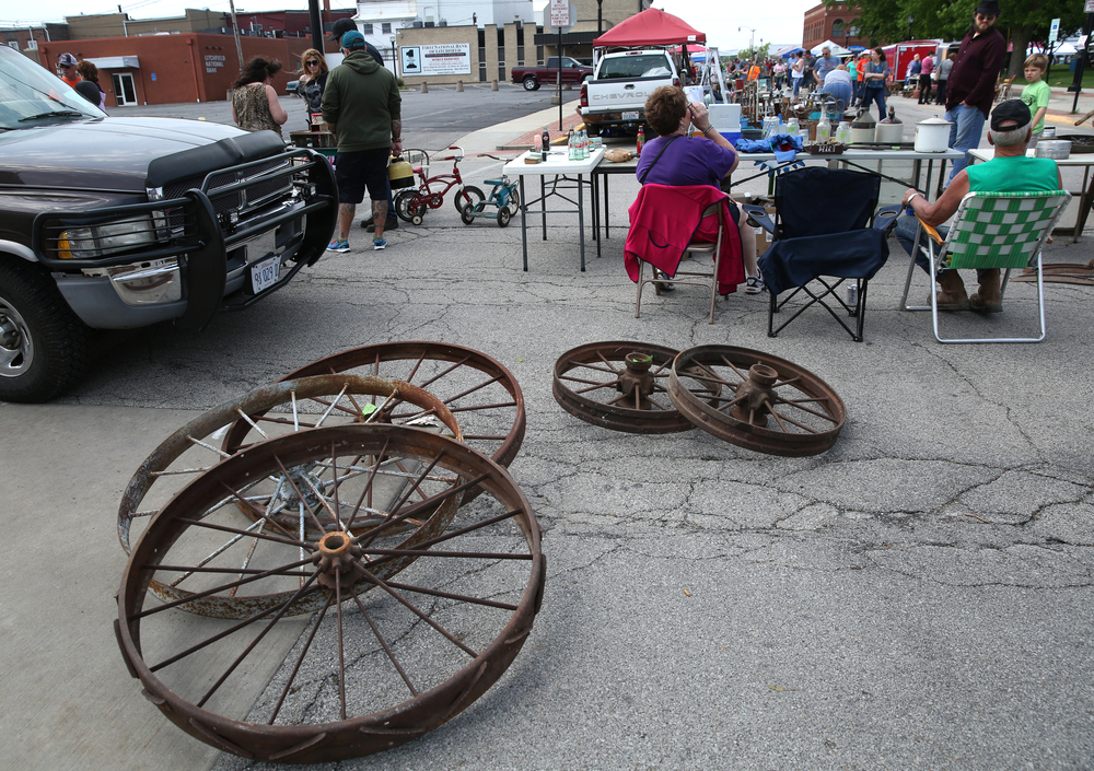 Kenny Heuer of Dorsey, Ill was selling antique steel wheels for around $40.00 each on Sunday. David Spencer/The State Journal-Register