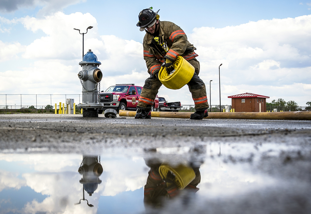 Matt Ostermeier, a driver/engineer for Engine One of the Springfield Fire Dept., deploys a 5-inch supply line to connect a hydrant to an engine during training exercises at the Illinois State Fairgrounds, Tuesday, May 3, 2016, in Springfield, Ill. Firefighters from the department were conducting the exercises for connecting engines to hydrants for a water supply to feed engines fighting fires. Justin L. Fowler/The State Journal-Register