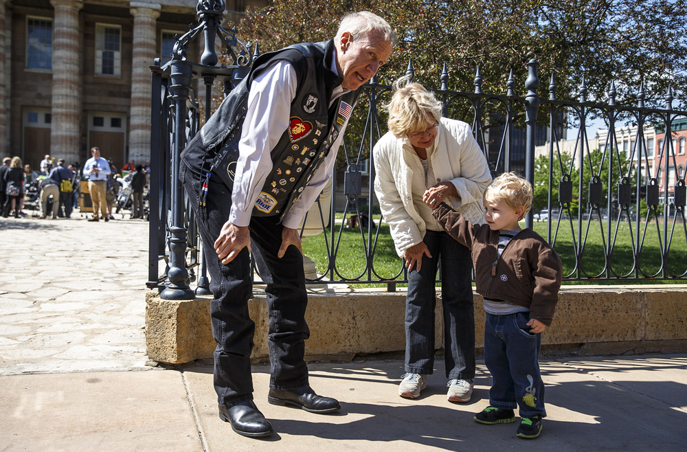 Illinois Gov. Bruce Rauner visits with Sandy Nickell, right, and her grandson, Jameson, after giving a speech at an event by the Illinois Dept. of Transportation kicking off Motorcycle Awareness Month and to launch the annual ÒStart Seeing MotorcyclesÓ campaign at the Old State Capitol, Tuesday, May 3, 2016, in Springfield, Ill. Justin L. Fowler/The State Journal-Register