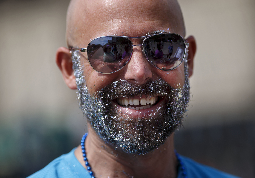 Steve Foster used beard oil and glitter to create his race-day look for the Fat Ass 5K in downtown Springfield Saturday, May 7, 2016. Ted Schurter/The State Journal-Register