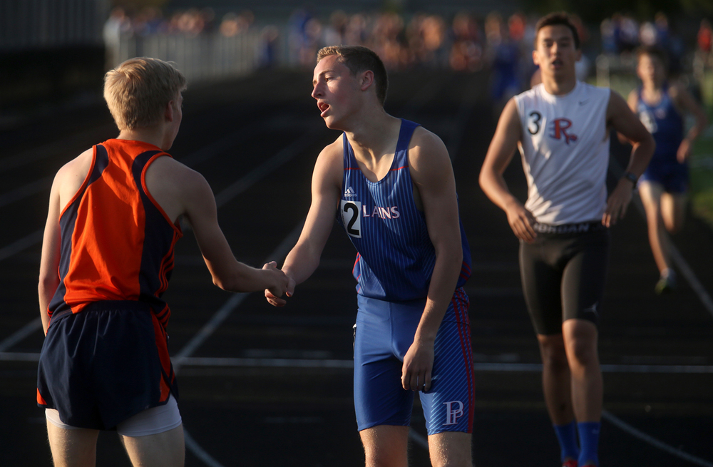 In the end of the boys 800 meter run, winner Josh Cable of Rochester at left shakes hands with second place finisher David Plunkett of Pleasant Plains. The Sangamon County Invitational coed track meet took place at Rochester High School on Friday, May 6, 2016. David Spencer/The State Journal-Register
