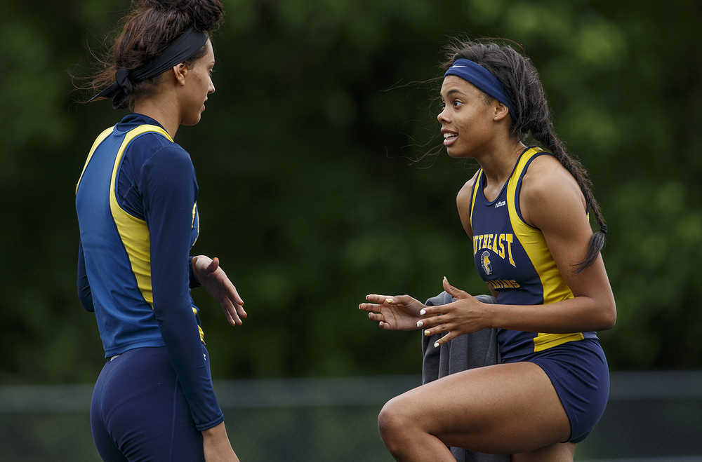 Southeast's Jamari Drake, right, talks strategy with teammate Lunden Henry as she competes in the high jump during the Class 2A girls sectional track meet at Rochester High School Friday, May 13, 2016. Drake and Henry finished first and second in the event. Ted Schurter/The State Journal-Register