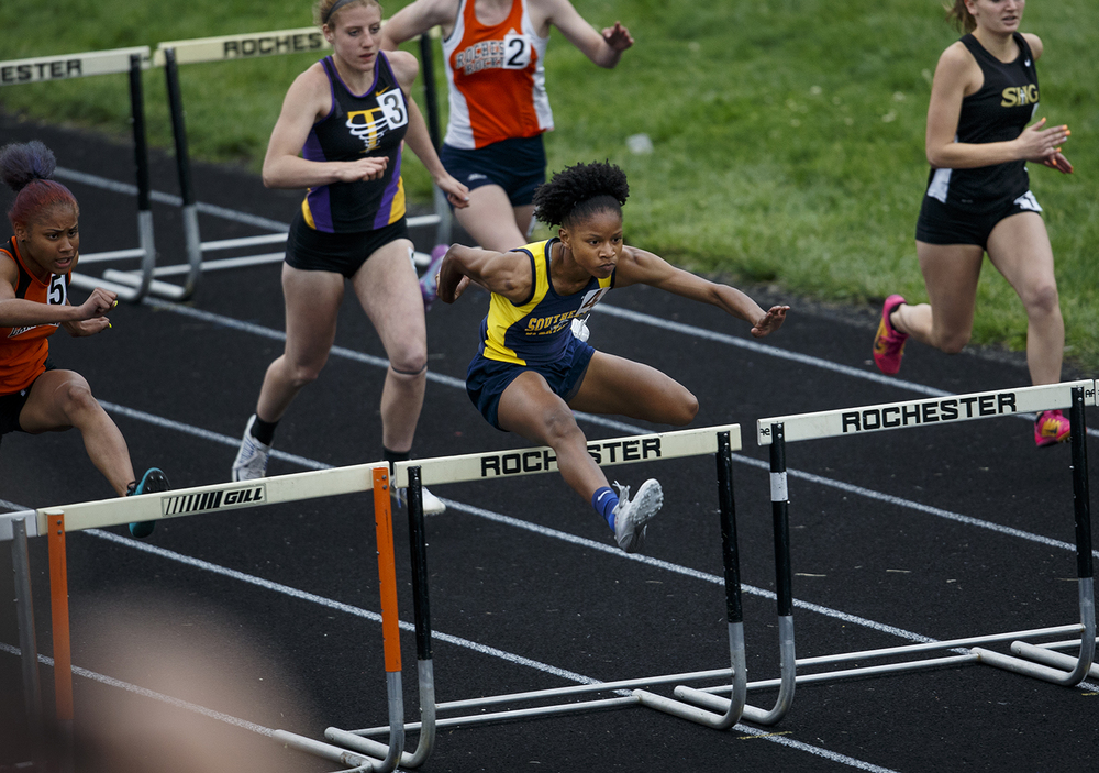 Southeast's Dontavia Howard sprints to an early lead and the win in the 100 meter hurdles during the Class 2A girls sectional track meet at Rochester High School Friday, May 13, 2016. Ted Schurter/The State Journal-Register