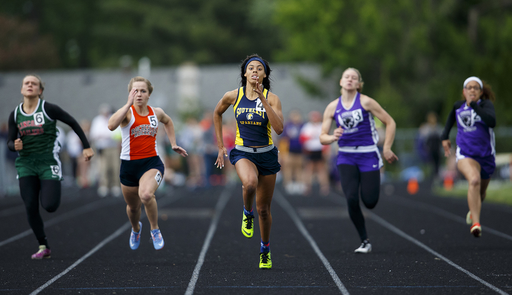 Southeast's Jamari Drake wins the 100 meter dash during the Class 2A girls sectional track meet at Rochester High School Friday, May 13, 2016. Ted Schurter/The State Journal-Register