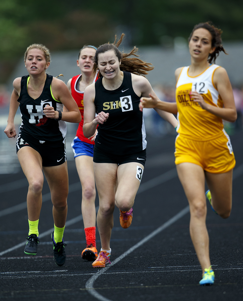 Sacred Heart-Griffin's Grace McDonald lunges for the finish line and third place in the 800 meter run during the Class 2A girls sectional track meet at Rochester High School Friday, May 13, 2016. Ted Schurter/The State Journal-Register