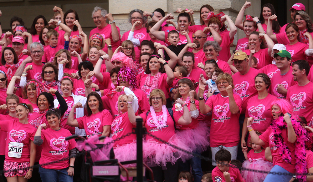 "Some of the 180 team members of the ""Breast Friends Forever"" team strike a pose for a group photo before the start of the race. David Spencer/The State Journal-Register"